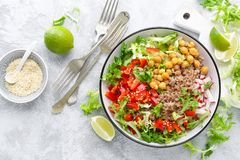 Healthy and delicious bowl with buckwheat and salad of chickpea, fresh pepper and lettuce leaves. Dietary balanced plant-based foo royalty free stock images