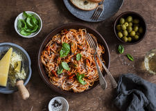 Healthy delicious lunch - spaghetti with tomato sauce and mussels on a wooden table, top view. royalty free stock photography