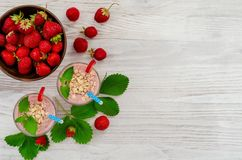 Healthy delicious smoothie from banana and fresh berries stock images