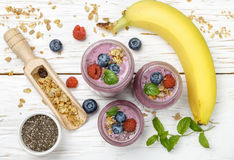 Healthy delicious smoothie from banana and fresh berries Royalty Free Stock Photos