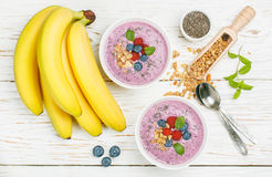 Healthy delicious smoothie from banana and fresh berries Royalty Free Stock Images