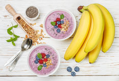 Healthy delicious smoothie from banana and fresh berries Stock Photos