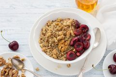 Quinoa with fresh cherries, walnuts and honey Royalty Free Stock Photo