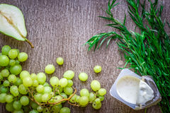 Healthy and delicious yogurt with green grape Stock Photos