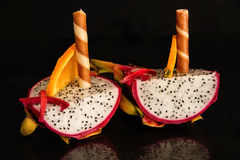 Healthy dessert. Dragon Tropical Fruit with chocolate waffle rolls Royalty Free Stock Photo