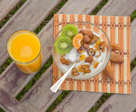 Healthy dessert and a glass of orange juice Royalty Free Stock Photo