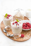 Healthy dessert with oatmeal, whipped cream and raspberries Royalty Free Stock Images