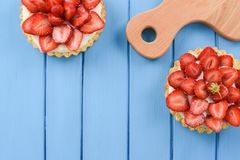 Healthy dessert with seasonal berries. Tratlets decorated with f royalty free stock photography