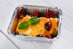 Healthy dessert. Sweet baked rice pudding in foil box Royalty Free Stock Photography