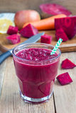 Healthy detox beetroot, carrot, apple and lemon juice smoothie, vertical Stock Photo