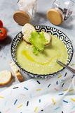 Healthy detox broccoli green cream soup in a bowl on concrete table.  royalty free stock photos