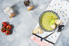 Healthy detox broccoli green cream soup in a bowl on concrete table. Top view royalty free stock images