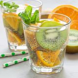 Healthy detox chia seed drink with kiwi, orange and mint in glass, square format stock image
