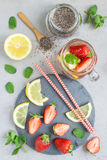 Healthy detox chia seed drink with strawberry, lemon and mint in glass jar, top view stock photos