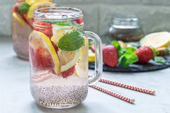 Healthy detox chia seed drink with strawberry, lemon and mint in jar, horizontal stock image