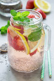 Healthy detox chia seed drink with strawberry, lemon and mint in jar, vertical royalty free stock photo