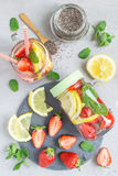 Healthy detox chia seed drink with strawberry, lemon and mint in jar, vertical, top view royalty free stock photos