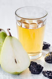 Healthy detox meal of apple juice, pear and prunes Royalty Free Stock Image