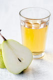 Healthy detox meal of apple juice, pear and prunes. Glass of apple juice with pear for a healthy liquid detox meal to aid digestion Stock Photo
