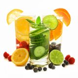 Healthy detox water with fresh fruit over white Royalty Free Stock Photos