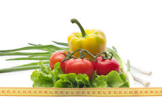 Healthy diet. Vegetables and measuring tape, still life isolated on white Royalty Free Stock Image