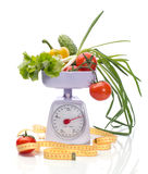 Healthy diet. Healthy food on weights and measuring tape on white background Stock Image