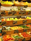 Healthy diet. Baskets of fruit and vegetables in a grocery store stock photos