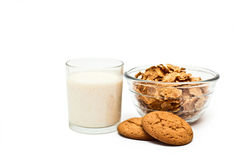 Healthy diet breakfast. Cereals, oatmeal cookies and yogurt in a glass on a white background Stock Photography