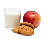 Healthy diet breakfast. Apple, oatmeal cookies, and yogurt in a glass on a white background Royalty Free Stock Photography