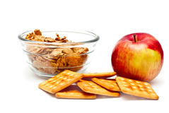 Healthy diet breakfast. Corn flakes in a glass bowl, apple and cookies on a white background Stock Images