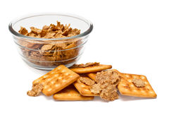Healthy diet breakfast. Corn flakes in a glass bowl and cookies on a white background Stock Photography