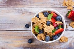 Healthy diet breakfast. Oatmeal flakes and berries. Fitness, sport or healthy lifestyle concept. Copy space Royalty Free Stock Image