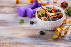 Healthy diet breakfast. Oatmeal flakes and berries. Fitness, sport or healthy lifestyle concept. Copy space Royalty Free Stock Photo