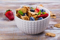 Healthy diet breakfast. Oatmeal flakes and berries. Fitness, sport or healthy lifestyle concept. Copy space Stock Photography