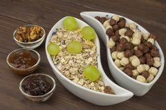 Healthy Diet breakfast of oatmeal, cereal and fruit. Foods full of energy for athletes. The concept of diet food. Stock Photos