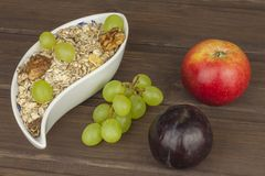 Healthy Diet breakfast of oatmeal, cereal and fruit. Foods full of energy for athletes. The concept of diet food. Preparing homemade breakfast. Vegetarian diet Stock Images