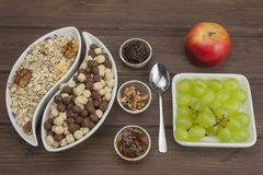 Healthy Diet breakfast of oatmeal, cereal and fruit. Foods full of energy for athletes. The concept of diet food. Royalty Free Stock Image