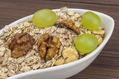 Healthy Diet breakfast of oatmeal, cereal and fruit. Foods full of energy for athletes. The concept of diet food. Stock Photo
