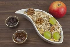 Healthy Diet breakfast of oatmeal, cereal and fruit. Foods full of energy for athletes. The concept of diet food. Royalty Free Stock Photo