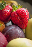 Healthy diet. Close up of a strawberry and some other fruits Stock Photos