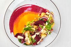 Healthy diet: colorful beetroot salad with potatoes and shredded leaves. Close up Royalty Free Stock Photography