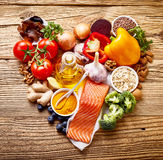 Healthy diet concept for the heart. And cardiovascular system with assorted fresh foods rich in omega-3 fatty acids and antioxidants arranged in a heart-shaped Stock Photography