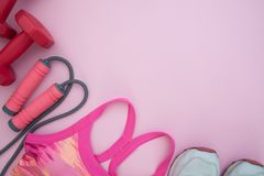 Healthy and Diet concept, Sport equipments on pink pastel backgr Royalty Free Stock Images