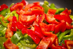 Healthy diet: cooking sliced peppers Stock Images