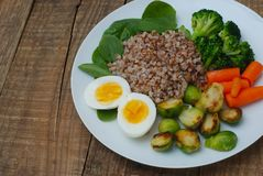 Healthy Diet Fitness Healthy Diet Buckwheat Egg Boiled Half Salad Brussele Cabbage Carrots Copy Space. Healthy Diet Fitness Healthy Diet Buckwheat Egg Boiled Stock Image