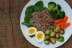Healthy Diet Fitness Healthy Diet Buckwheat Egg Boiled Half Salad Brussele Cabbage Carrots Copy Space. Healthy Diet Fitness Healthy Diet Buckwheat Egg Boiled Royalty Free Stock Photography