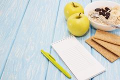 Healthy diet, fitness and weight loss concept, apple, notepad, pencil, on the table. View from above. Healthy diet, fitness and weight loss concept, apple Royalty Free Stock Images