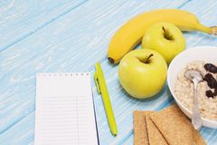 Healthy diet, fitness and weight loss concept, apple, notepad, pencil, on the table. View from above. Healthy diet, fitness and weight loss concept, apple Royalty Free Stock Photos