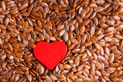 Healthy diet. Flax seeds linseed as food background and red heart Stock Photography