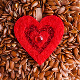 Healthy diet. Flax seeds linseed as food background and red heart Royalty Free Stock Image